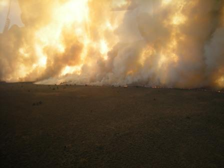 An immense wall of flame and smoke sweep across the desert Monday at the Rush Fire - Photo by Phil Perkins