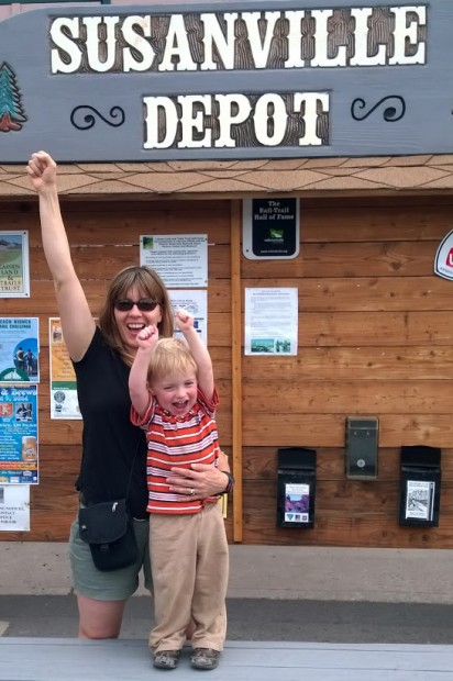 Jennifer Jardine and son in front of the historic railroad depot on Richmond Road.