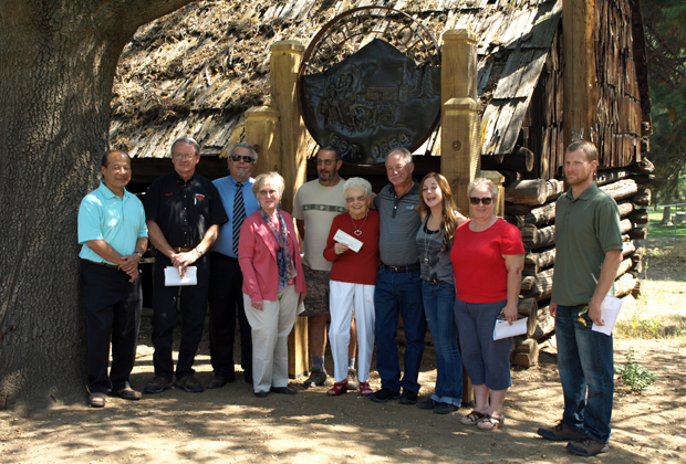 Pictured in front of Roop's Fort are Sunrise Rotarians Norman Mah, Arlin Billington, Steve King, and Karen Grosz, Historical Society President Tony Jonas, Rotarian Michelle Zubillaga and Susanville's Mayor Pro Tem Nick McBride.