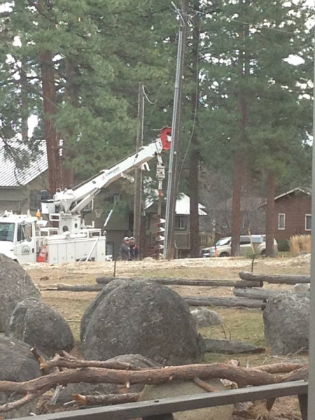 Roxanna sends these photos taken Saturday morning and LMUD crews worked on down power lines.