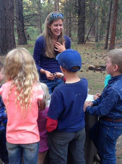 Kids have fun with snakes at last year's Eagle Lake campfire talk featuring Dr. Amanda Sparkman