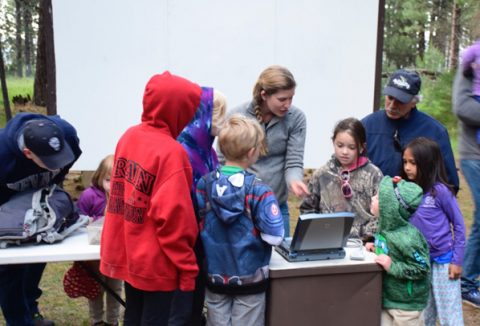 Dr. Amanda Sparkman  showing the ultrasound images of a Western Garter snake at Eagle Lake Nature Program, Merrill Amphitheater last Saturday. ~photo by Annie Henriques.