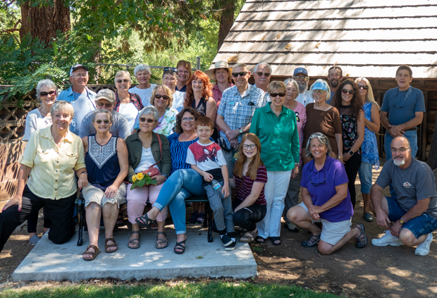 Family and friends of Zellamae Miles gather at a dedication ceremony for a bench at Roop's Fort